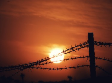 """Photography titled """"Sunset over barbed…"""" by Ravid Wolff, Original Art, Digital Photography"""