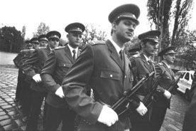 BUDAPEST POLICEMEN BEFORE A PARADE - Photography ©2001 by Alessandra Benedetti -