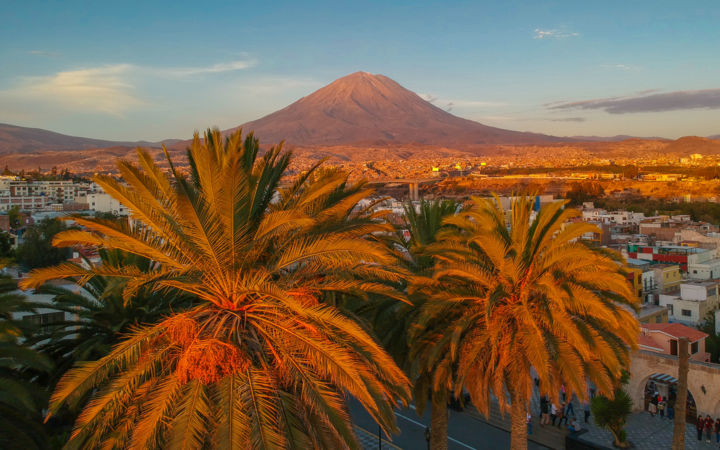 New Height in Peru - © 2018 travel photography, peru, south america, volcano, sunset, golden hour, golden light, beautiful light, exotic, parm trees Online Artworks