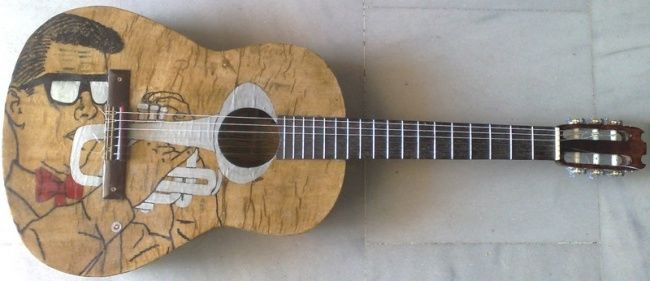Amazing paper guitar - great sound - Artcraft,  99x38 cm ©2011 by Chris Tsonias -            eco green unique and amazing classic guitar made from  used paper