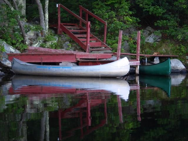 Boats at Dock - Photography,  10x8 in ©2009 by Cynthia Brown Yackenchick -            Canoes docked on Upper Goose Pond, at AMC Hut along Appalachian Trail