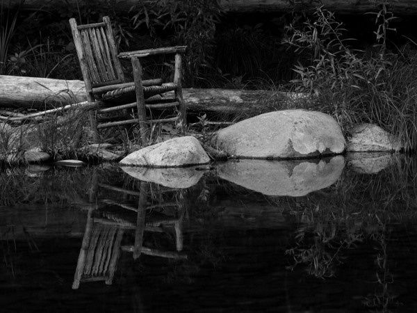 Reflecting on the River - Photography ©2012 by Cynthia Brown Yackenchick -            Reflection of old chair on waters edge at the Green River