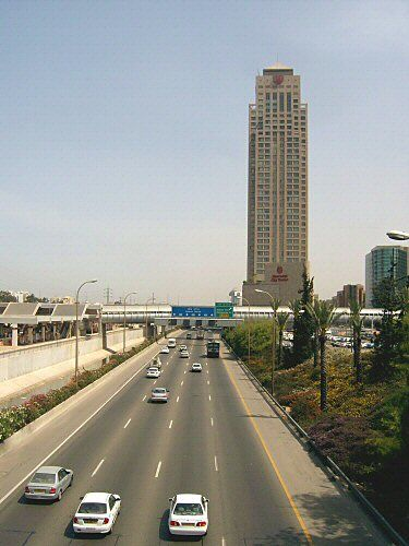 Skyscraper 3 - Photography, ©2004 by Efi Keren -                                                                                                                                                                                                                                                                                                                                                                                                                                                                                                                                                                                                                                                                                                                                                                                                                                                                                                                                  highway, road, main, interstate, expressway, route, passage, way, high-speed travel, traffic, car, automobile, auto, vehicle, means, cars, city, urban, municipal, town