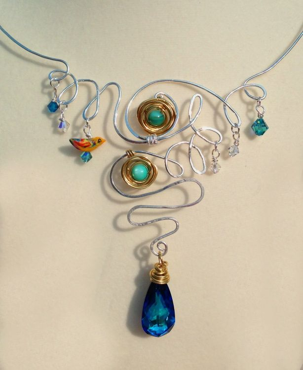 Artisan crafted jewelry,  Gloria Nilsson,  Swarovski crystals,  semi-precious stones,  pearls,  black spinel,  polymer clay hand sculptured beads,   wire wrapping,  hand forged chain and ear wires