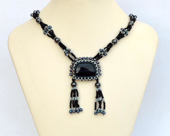 Hawk eye necklace with double tassel - Design, ©2007 by Ira Zelickman -                                                                                                                                                                                                                                              hawk eye necklace, blue black necklace, tassel necklace, tiger eye necklace, blue and black