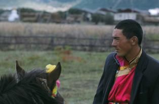 Man and horse - Photography, ©2003 by Jeff Fuchs -                                                              Tibet Horse Portrait Yunnan China