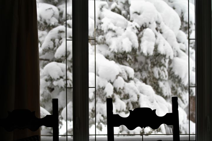 chairs against the window with snow outside nadine mitchell