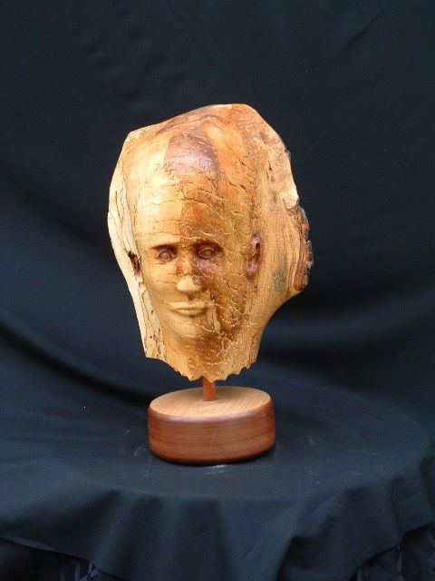 Ponderance - Sculpture,  12 in ©2009 by Diane Tremaine -            Sculpture of head.. You can see the young and the old